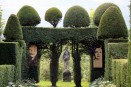 relief carving portraits amongst topiary